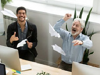 Managers launching paper planes