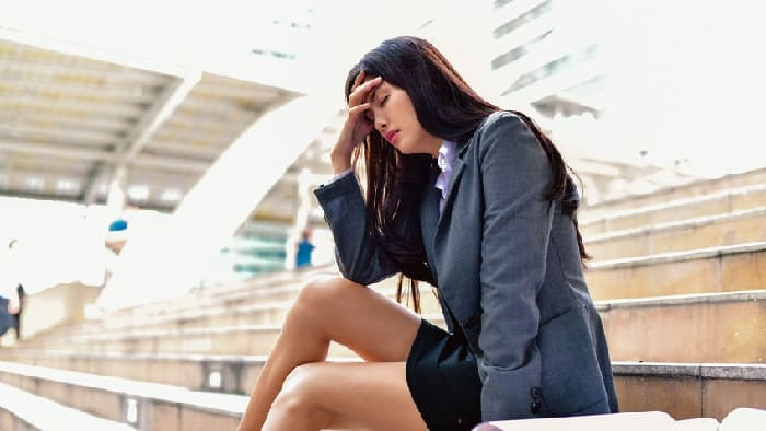 Woman feeling stressed and crying