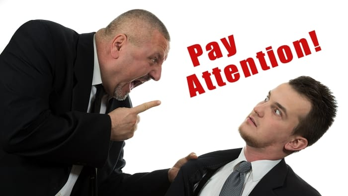 Manager screaming pay attention at colleague
